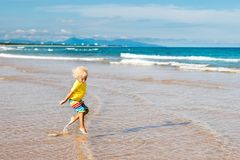Child on tropical beach. Sea vacation with kids. Stock Photography
