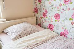 Child bed girls room pink colors. And wallpaper Royalty Free Stock Images