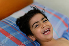 Child in bed Stock Images