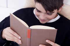 Child in bed reading Royalty Free Stock Photo