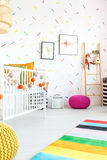 Child bedroom with cot. White child bedroom with cot and carpet Royalty Free Stock Image