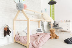 Child bedroom with diy bed. White child bedroom in scandinavian style with diy house bed royalty free stock photos