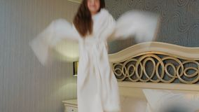 Child bedtime energy hyperactive girl jumping bed. Child bedtime. crazy kid energy. hyperactive overexcited smiling little girl jumping on her bed stock footage