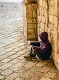 Child beggar in the street of Kotor Royalty Free Stock Photo