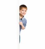 Child behind a board Royalty Free Stock Photos