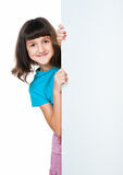 Child behind a board Stock Images