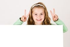 Child behind empty board Royalty Free Stock Photo