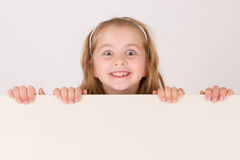 Child behind empty board Stock Photos