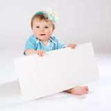 Child behind empty board Stock Images
