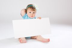 Child behind empty board Stock Image