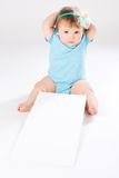 Child behind empty board Stock Photography