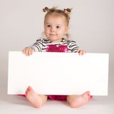 Child behind empty board Stock Photo