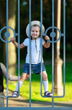 Child behind a fence Royalty Free Stock Image