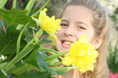 Child behind flower. Shot of a child behind flower Royalty Free Stock Photography