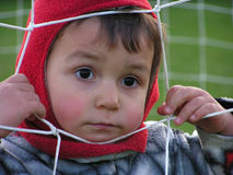 Child behind football net royalty free stock photography