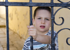 Child behind a gate or fence Royalty Free Stock Photos