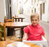 Child behind table Royalty Free Stock Image
