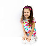 Child behind a white board Royalty Free Stock Photos