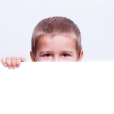 Child behind a white board Royalty Free Stock Photo