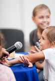 Child being interviewed Stock Photo