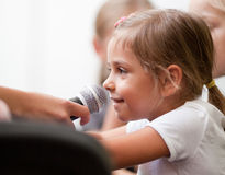 Child being interviewed royalty free stock photo