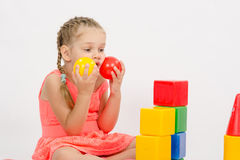 Child being played in developing a set of put two balls to the cheeks Stock Photos
