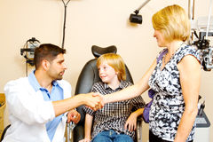 Child being updated on tests Royalty Free Stock Images