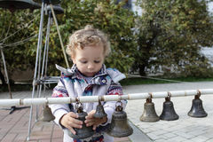 Child with bells Royalty Free Stock Photo