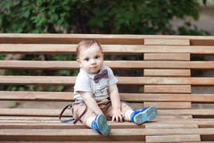Child on the bench Stock Images