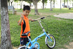 A child with bicycle Royalty Free Stock Image