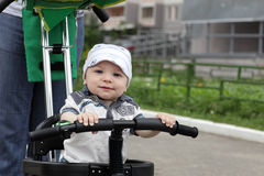 Child on bicycle Stock Photos