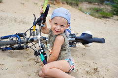 Child with a bicycle Royalty Free Stock Images