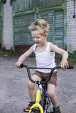 Child on a bicycle at asphalt road. Childhood. Sport. Cycling Royalty Free Stock Photography