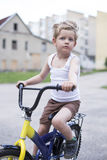 Child on a bicycle at asphalt road. Childhood. Sport. Cycling Royalty Free Stock Photo