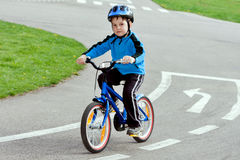 Child on a bicycle. At asphalt road on traffic playground Stock Photography