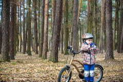 Child on a bicycle in the forest in early morning. Boy cycling o Royalty Free Stock Photo