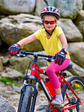 Child on bicycle ride mountain. Girl traveling in summer park. Royalty Free Stock Photo