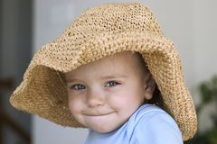 Child in a big hat Stock Photos