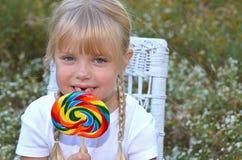 Child with big lollipop Stock Photo