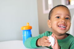 Child with big smile. Young child happy with something after having drink from cup and wipe hands Royalty Free Stock Photography