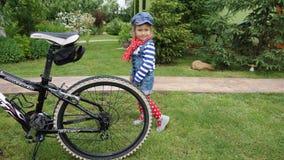 Child. With bike Stock Photo