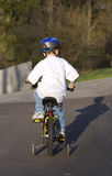 Child on Bike. With Training Wheels Royalty Free Stock Photo