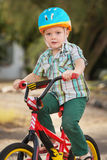 Child in Bike Helmet Riding Stock Photos