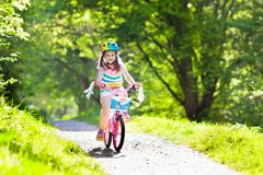 Child on bike. Kids ride bicycle. Girl cycling. Stock Images