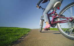 Child on a bike on a path Royalty Free Stock Image