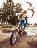 Child on bike racing forward. Stock Photo