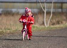 Child on bike royalty free stock photo