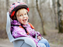 Child in bike seat Stock Photos