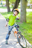 Child with bike stands on cycle lane Stock Photos