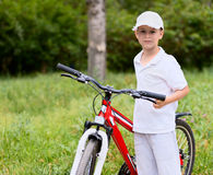 Child with bike Royalty Free Stock Image